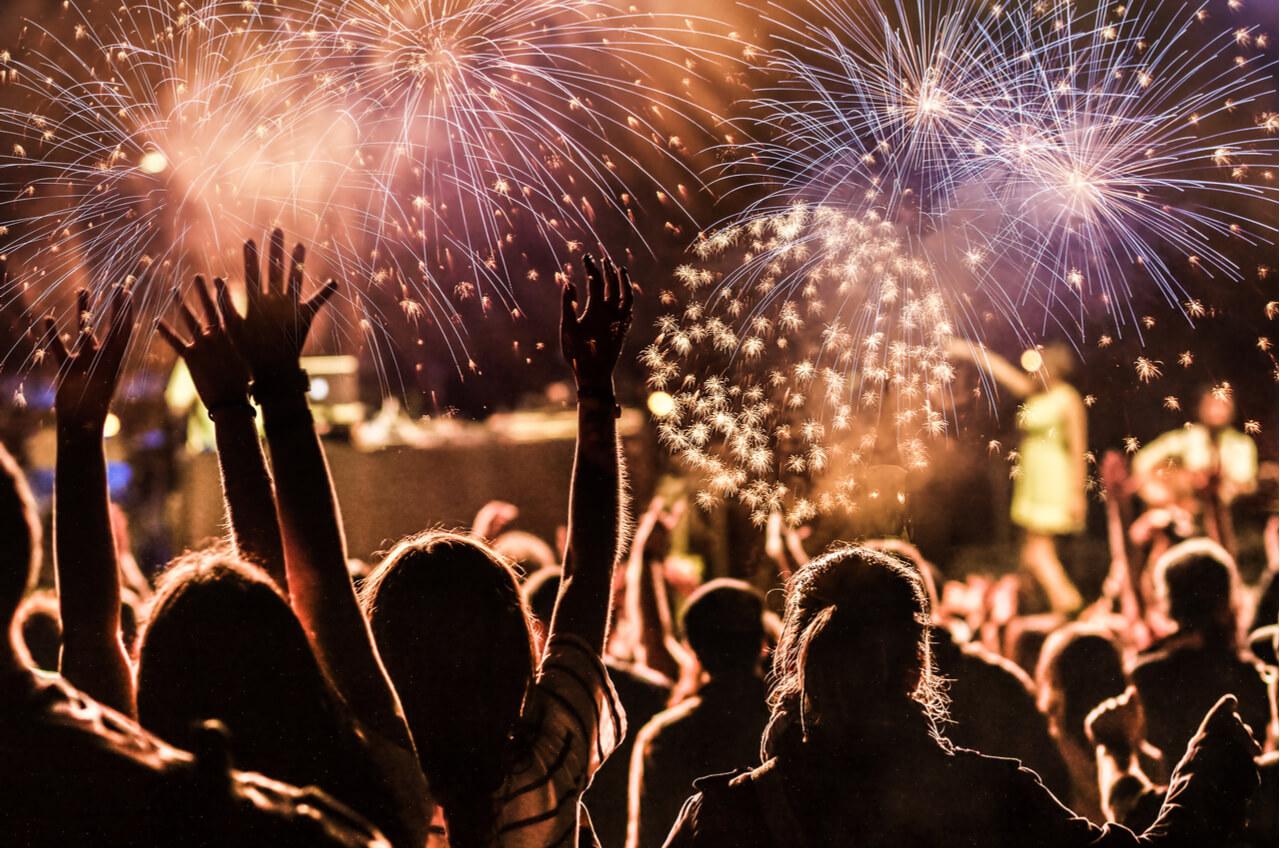 crowd watching fireworks at night